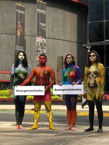 Acción civil con body paint en la Bolsa mexicana de Valores a fin de generar conciencia sobre la relación que existe entre el acelerado calentamiento global y el modelo de desarrollo económico prevaleciente